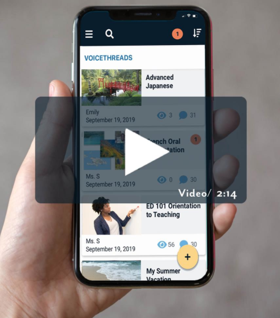 Hand holding a smartphone with a screenshot of the new VoiceThread mobile app displayed